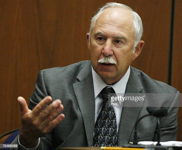 Forensic specialist James Pex testifies during the murder trial of music producer Phil Spector in Superior Court July 18 2007 in Los Angeles...