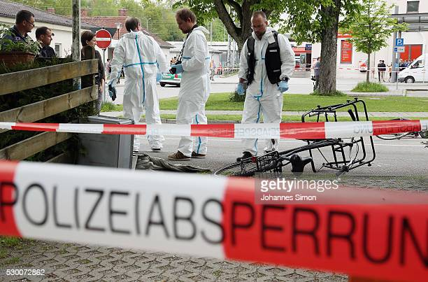 Forensic specialists of the German police secure the crime scene after a deadly knife attack on May 10 2016 in Grafing Bavaria One person has died...