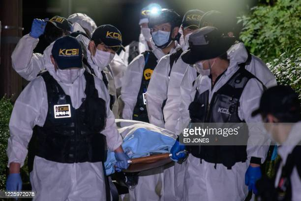 Forensic team carry the body of Seoul mayor Park Won-soon after rescue teams discovered his body following reports that he had been missing since...