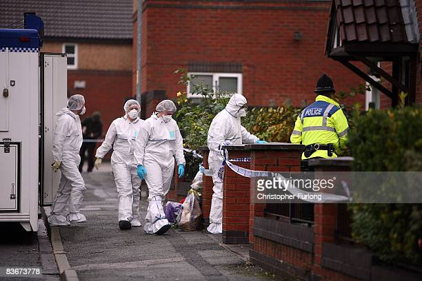 A forensic team enter the house in Kilmington Drive Cheetham Hill where threemonthold Delayno Marco MullingsSewell and his brother threeyearold...