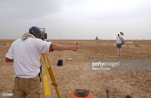 A forensic team member from the Centre for Forensic Science Technology and Law of the Inforce Foundation gestures as he investigates the area with a...