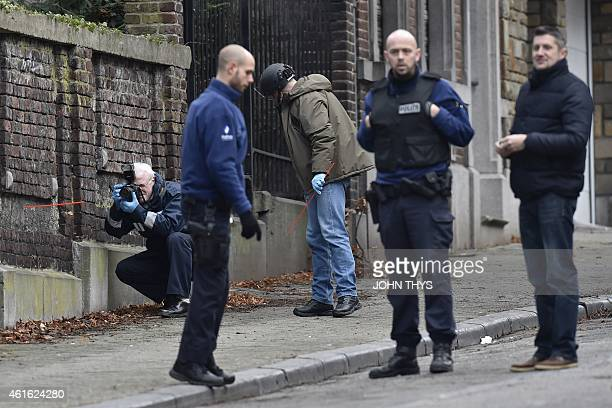 A forensic team members work at Colline street in Verviers eastern Belgium on January 16 after police shot dead two suspects in a gun battle after...
