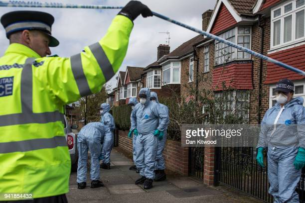 A forensic team search a street where a man died after a robbery on April 4 2018 in London England A man aged 78 has been arrested by police on...