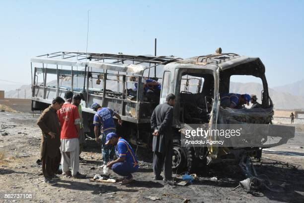 Forensic teams and security personnel carry out investigation at the scene after a blast targeted a truck carrying policemen on the outskirts of...