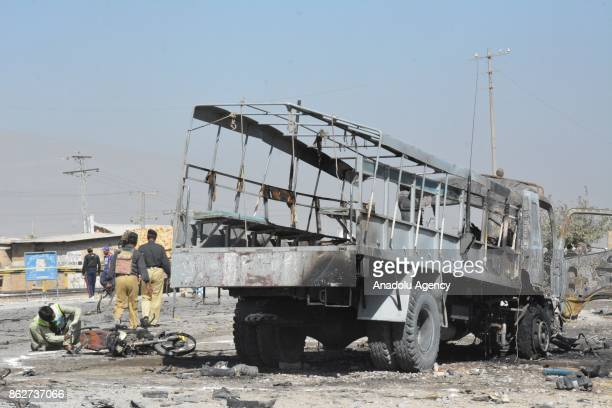 Forensic teams carry out investigation at the scene after a blast targeted a truck carrying policemen on the outskirts of Quetta the capital of...