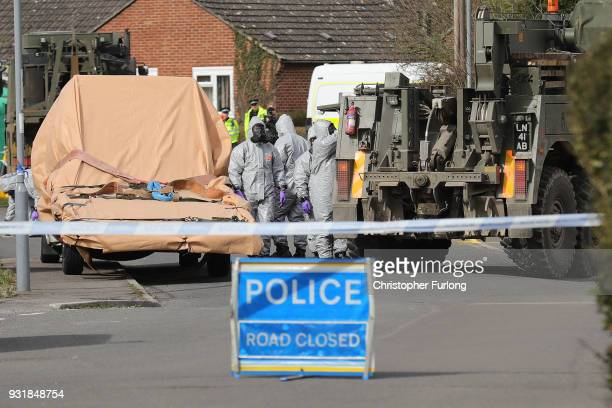 Forensic teams work at an address in Gillingham Dorset as they remove a recovery truck used following the Salisbury nerve agent attack on March 14...