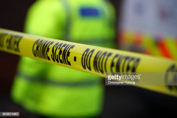 Forensic technicians work outside a home in Matlock Road Reddish after a body was found in a back garden on January 10 2018 in Stockport England...