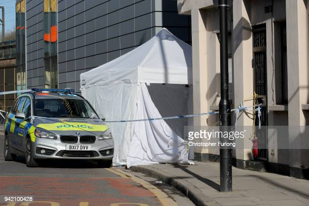 A forensic tent covers the scene where a man aged 20 collapsed after being fatally stabbed last night near Link Street Hackney on April 5 2018 in...