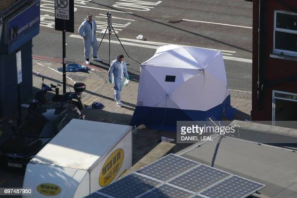 TOPSHOT A forensic tent is erected at the scene in Finsbury Park area of north London after a vehichle hit pedestrians on June 19 2017 A van ploughed...