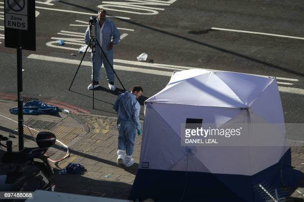 A forensic tent is erected at the scene in Finsbury Park area of north London after a vehichle hit pedestrians on June 19 2017 A van ploughed into...