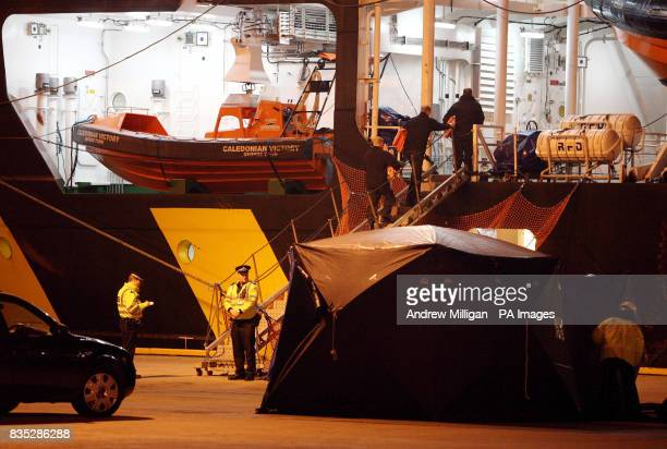 Forensic tents are put up around the Caledonian Victory vessel which arrived at Aberdeen Harbour early this morning The boat was carrying the bodies...