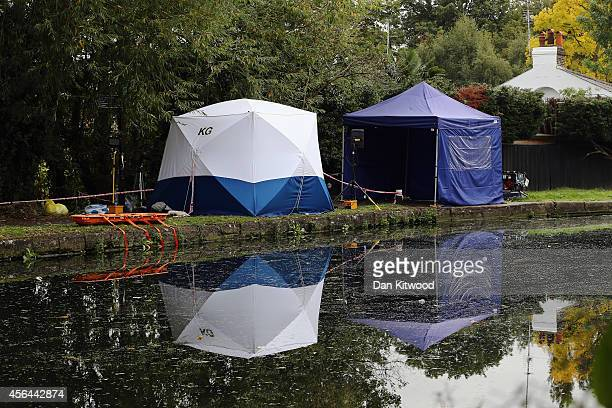 Forensic tents stand beside the Grand Union Canal on October 1 2014 in London England The disappearance of teenager Alice Gross is now being treated...