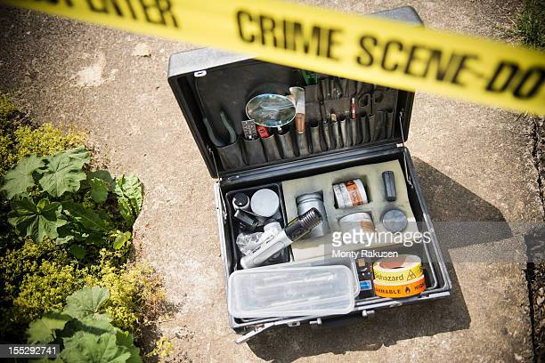 forensic toolkit at crime scene with police tape - forense fotografías e imágenes de stock