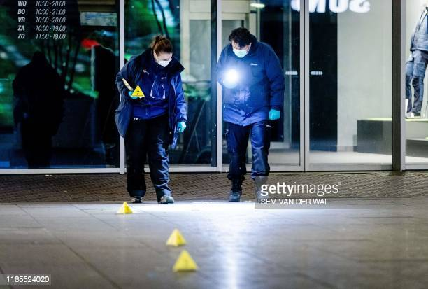 Forensic workers investigate at the Grote Marktstraat one of the main shopping streets in the centre of the Dutch city of The Hague after several...