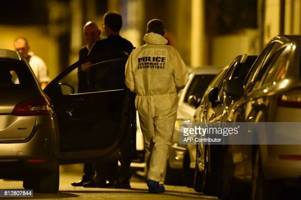 Forensics and police officers cordon off the area next to the house of late French magistrate JeanMichel Lambert who was found dead at his home on...