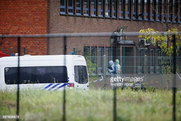 TOPSHOT Forensics enter the National Institute for Criminalistics and Criminology to inspect the site of an explosion that happened early on August...