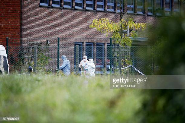 Forensics enter the National Institute for Criminalistics and Criminology to inspect the site of an explosion that happened early on August 29 in...