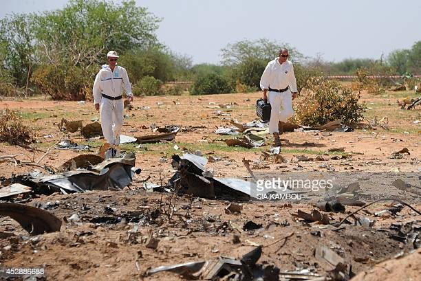 Forensics gather evidence at the crash site of the Air Algerie AH5017 in Mali's Gossi region on July 29 2014 France said on July 28 the pilots of the...
