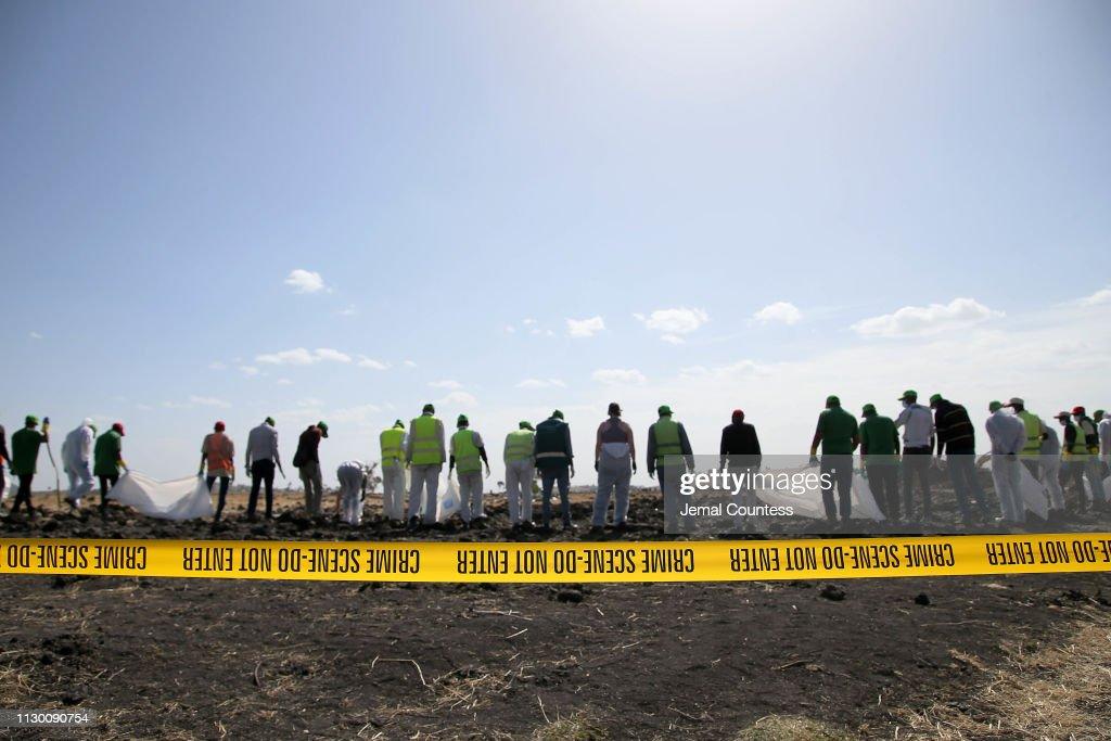 Emergency Services Work At The Crash Site Near Bishoftu Of Ethiopian Airlines ET302 To Nairobi : News Photo
