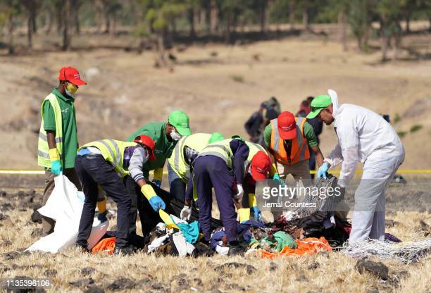 Forensics investigators and recovery teams collect personal effects and other materials from the crash site of Ethiopian Airlines Flight ET 302 on...