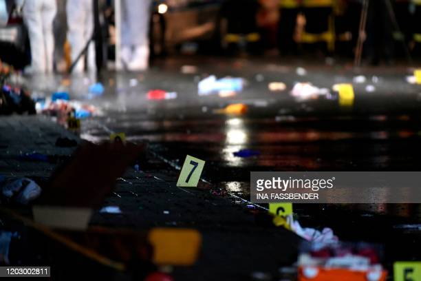 TOPSHOT Forensics numbers are seen at the place where a man drove into a carnival procession on February 24 2020 in Volkmarsen near Kassel central...