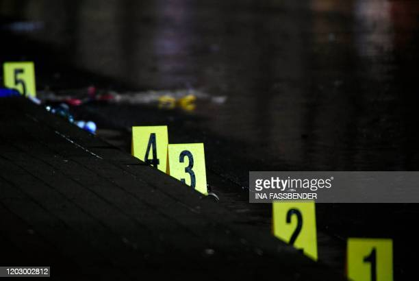 Forensics numbers are seen at the place where a man drove into a carnival procession on February 24 2020 in Volkmarsen near Kassel central Germany...