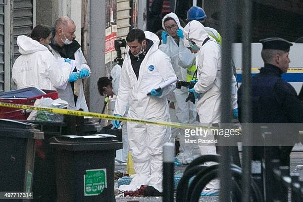 Forensics of the french police are seen in front of the '8 Rue du Corbillon' on November 18 2015 in SaintDenis France French Police special forces...