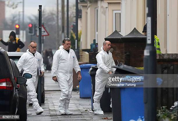 Forensics officers are seen attending a house on Leopold Street in Derby after reports of arrests under the Terrorism Act on December 12 2016 in...
