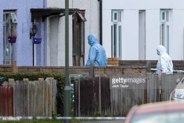 Forensics officers enter a property on Cavendish Road during a raid in connection with the terror attack at Parsons Green station on September 16...