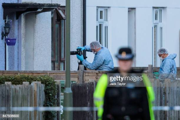 Forensics officers investigate a property on Cavendish Road during a raid in connection with the terror attack at Parsons Green station on September...