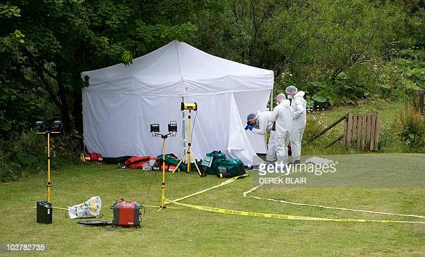 Forensics officers take pictures in Rothbury on July 10, 2010 as Raoul Thomas Moat, suspected of shooting three people in northeast England killed...