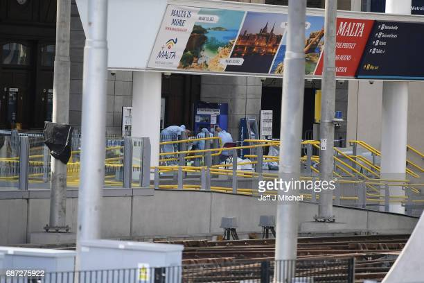 Forensics officers work at the scene at Manchester Arena on May 23 2017 in Manchester England At least 22 people were killed in a suicide bombing at...
