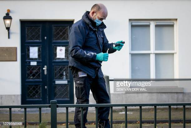 Forensics police officers investigate the Embassy of Saudi Arabia in The Hague on November 12 after it was shot Several shots were fired at the Saudi...