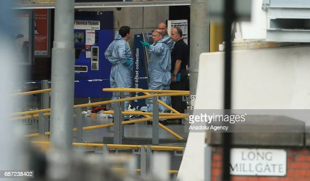 Forensics scientists look for evidence in the Manchester Arena stadium in Manchester United Kingdom on May 23 2017 A large explosion was reported at...