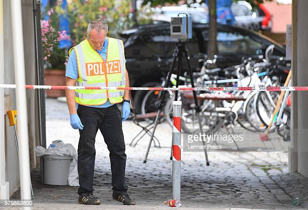 Forensics search the area of a suicide bomb attack at a music festival on July 25 2016 in Ansbach Germany According to police a 27yearold Syrian who...