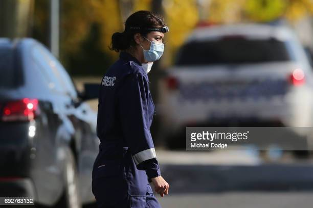 Forensics start their investigations outside service apartments on June 6 2017 in Melbourne Australia Police are treating an incident where an armed...