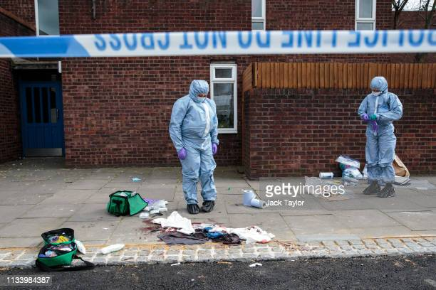 Forensics teams work at the scene of a stabbing in Edmonton on March 31, 2019 in London, England. Four people have been stabbed in a spate of knife...