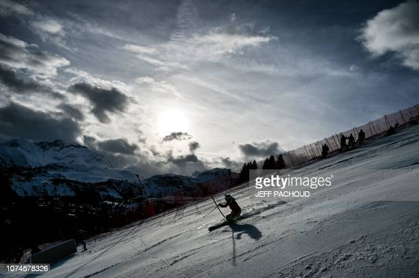 A forerunner skies the track prior to the FIS Alpine World Cup Women Slalom on December 22 2018 in Courchevel French Alps