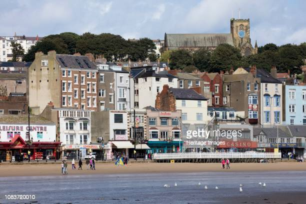 Foreshore Road, Scarborough, North Yorkshire, 2017. General view looking north-west from the beach towards shops, cafes and amusement arcades at the...