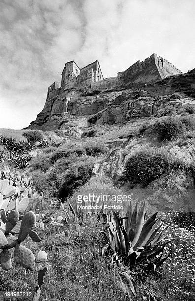 Foreshortened view of the fortress of Rocca Imperiale from below with the medieval towers and the walls with Ghibelline battlements the medieval...