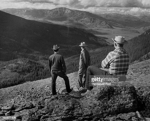 AUG 25 1957 Forest Advisory Council Makes Yearly Tour Three members of the Rio Grande National Forest advisory Council view portions of public domain...
