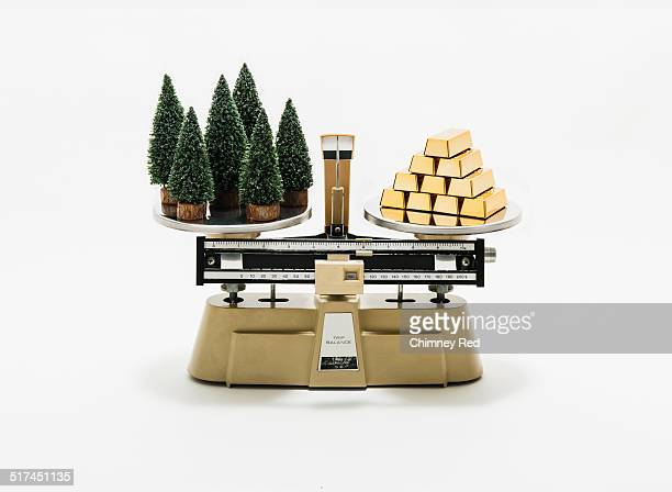 Forest and gold balanced on industrial scale