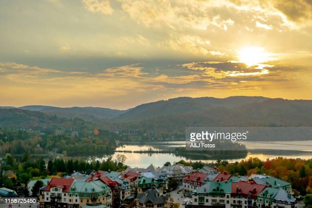 forest and mountain in fall at sunset. - mont tremblant stock pictures, royalty-free photos & images