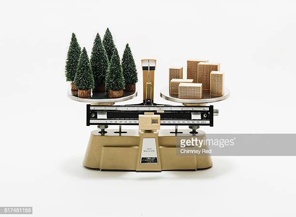 Forest & city balanced on industrial scales