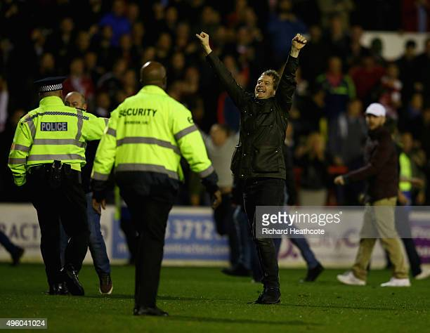 Forest fans invade the pitch at the final whistle during the Sky Bet Championship match between Nottingham Forest and Derby County at City Ground on...