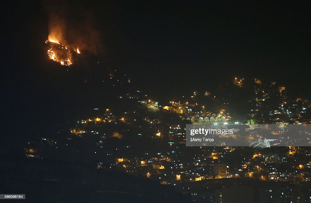 A forest fire burns near Maracana stadium during opening ceremonies for the Rio 2016 Olympic Games on August 5, 2016 in Rio de Janeiro, Brazil. The Rio 2016 Olympic Games commenced tonight at the iconic stadium.