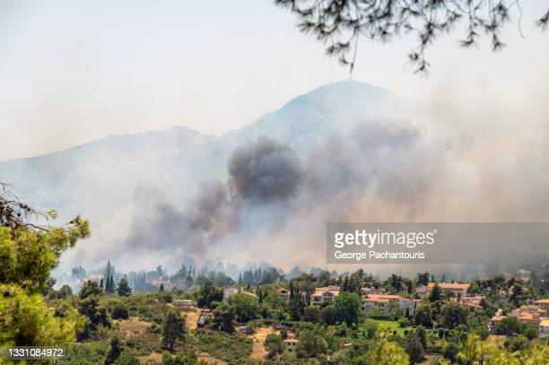 forest fire in a residential area in the summer - greece stock pictures, royalty-free photos & images
