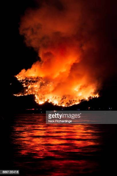 A forest fire reflected in Okanagan Lake, British Columbia, Canada