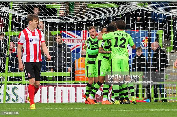 Forest Green Rovers' Christian Doidge celebrates scoring the opening goal with team mates during the Vanarama National League match between Forest...