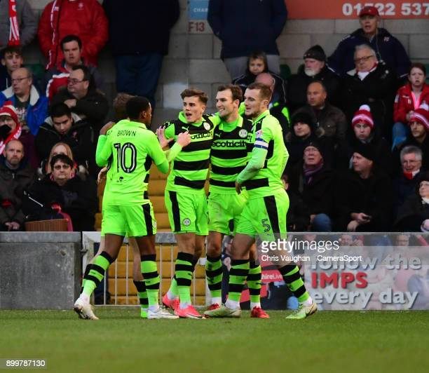 Forest Green Rovers' Christian Doidge second in from right celebrates scoring his sides equalising goal to make the score 11 with teammates from left...